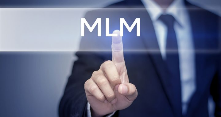 Businessman hand touching MLM button on virtual screen