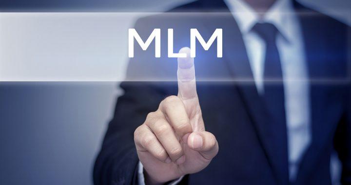 Businessman hand touching MLM button on virtual screen